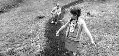 Children running through the woods